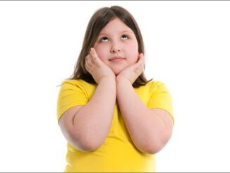 person suffering from childhood obesity